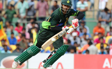 Pakistan cricketer Mohammad Hafeez plays a shot during the first one day international (ODI) cricket match between Sri Lanka and Pakistan at The Rangiri Dambulla International Cricket stadium in Dambulla, on July 11, 2015. (AFP)