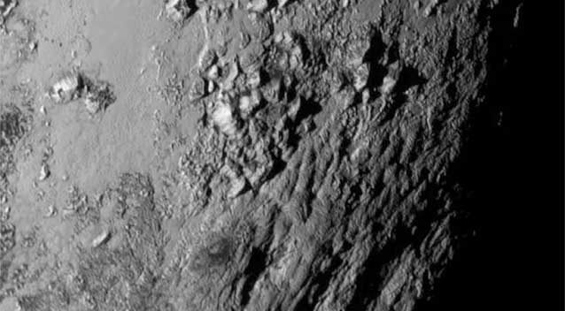 A close-up image of a region near Pluto's equator which is home to a range of youthful mountains rising as high as 3500 metres above the surface of the icy body. (AFP)