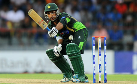 Pakistan batsman Sarfraz Ahmed plays a shot d during the third one day international  between Sri Lanka and Pakistan at the R. Premadasa International Cricket Stadium in Colombo on July 19, 2015. (AFP)