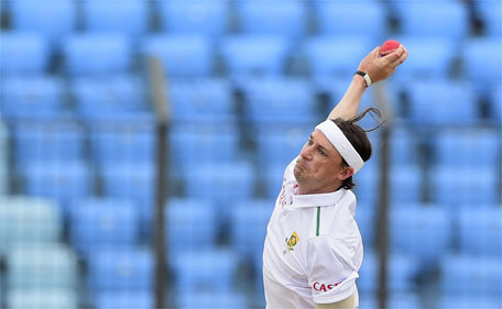 South Africa cricketer Dale Steyn delivers a ball during the third day of the first cricket Test match between Bangladesh and South Africa at Zahur Ahmed Chowdhury Stadium in Chittagong on July 23, 2015. (AFP)