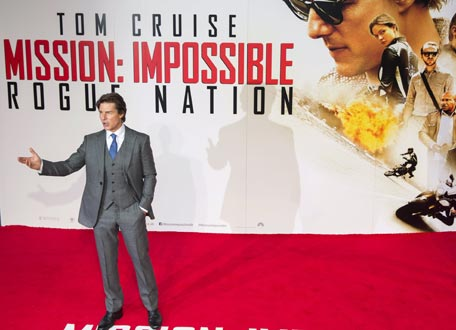 "U.S. actor Tom Cruise poses for photographers at a British screening of the film ""Mission Impossible: Rogue Nation"" in London, Britain July 25, 2015. REUTERS"