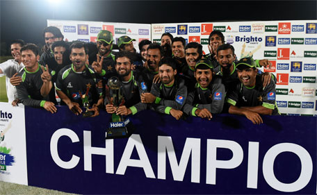 Pakistan cricketers pose after their team's series victory following the fifth and final one day international (ODI) cricket match between Sri Lanka and Pakistan at the Suriyawewa Mahinda Rajapakse International Cricket Stadium in the southern district of Hambantota on July 26, 2015. (AFP)