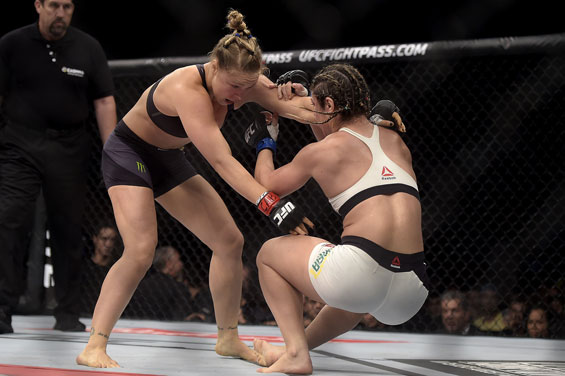 Ronda Rousey, left, of the United States, battles Brazil's Bethe Correia during their mixed martial arts bantamweight title fight at UFC 190 in Rio de Janeiro, Brazil. (AP)
