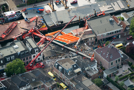 The two cranes that have fallen onto houses in Alphen aan den Rijn. (AFP)
