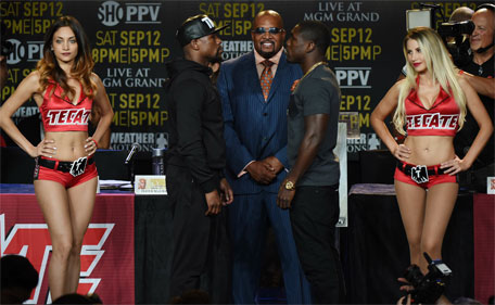 Boxers Floyd 'Money' Mayweather (left) and Andre Berto (right) face off during a press conference at the Marriott Hotel in Los Angeles, California on August 6, 2015 to officially announce their September 12th fight that will place at the MGM Grand Garden Arena in Las Vegas.   (AFP)