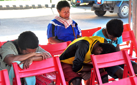 Relatives of passengers on the missing Trigana Air Service flight sit at Sentani airport in Jayapura, Papua province, Indonesia, Monday, Aug. 17, 2015. Rescue officials spotted an Indonesian airliner that went missing on Sunday in the country's mountainous easternmost province of Papua and rescue teams were preparing to try to reach the crash site by air and foot. (AP)