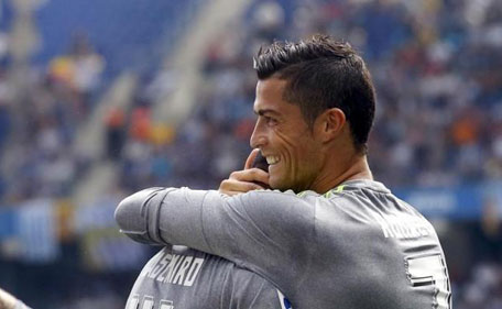 Real Madrid's Cristiano Ronaldo (right) celebrates a goal against Espanyol during their Spanish first division soccer match in Cornella de Llobregat, near Barcelona, Spain, September 12, 2015. (Reuters)