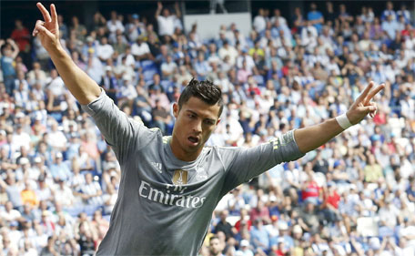 Real Madrid's Cristiano Ronaldo celebrates a goal against Espanyol during their Spanish first division soccer match in Cornella de Llobregat, near Barcelona, Spain, September 12, 2015. (Reuters)