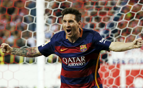 Barcelona's Lionel Messi celebrates after scoring a goal against Atletico Madrid during their Spanish first division soccer match at Vicente Calderon stadium in Madrid, September 12, 2015. (Reuters)