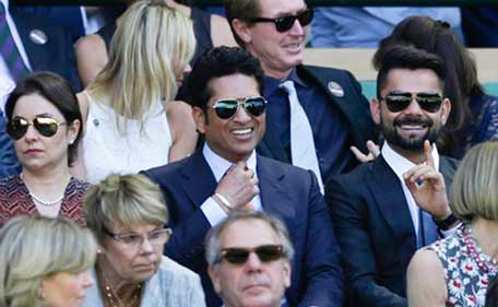 Virat Kohli (R) and Sachin Tendulkar at Wimbledon on July 10, 2015y. (AP)