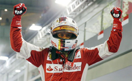 Ferrari Formula One driver Sebastian Vettel of Germany reacts after winning the Singapore F1 Grand Prix at the Marina Bay street circuit September 20, 2015. (Reuters)