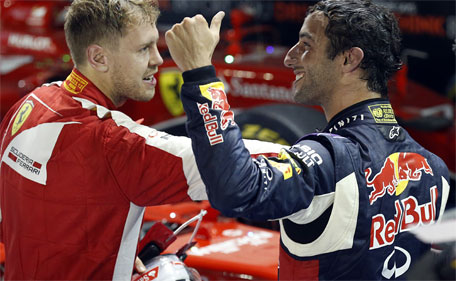 Red Bull driver Daniel Ricciardo (right) of Australia gives a thumbs up after finishing second behind Ferrari driver Sebastian Vettel of Germany at the end of the Singapore Formula One Grand Prix on the Marina Bay City Circuit in Singapore, Sunday, Sept. 20, 2015. (AP)