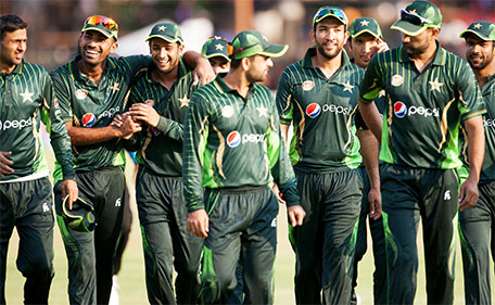 Pakistan players leave the field after winning the first of two T20 cricket matches between Pakistan and hosts Zimbabwe at the Harare Sports Club on September 27, 2015. (AFP)