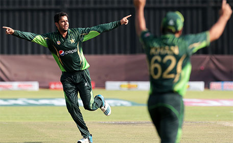 Pakistan's bowler Imad Wasim (left) celebrates a wicket during the first of two T20 cricket matches between Pakistan and hosts Zimbabwe at the Harare Sports Club on September 27, 2015. Pakistan defeated Zimbabwe by 13 runs. (AFP)