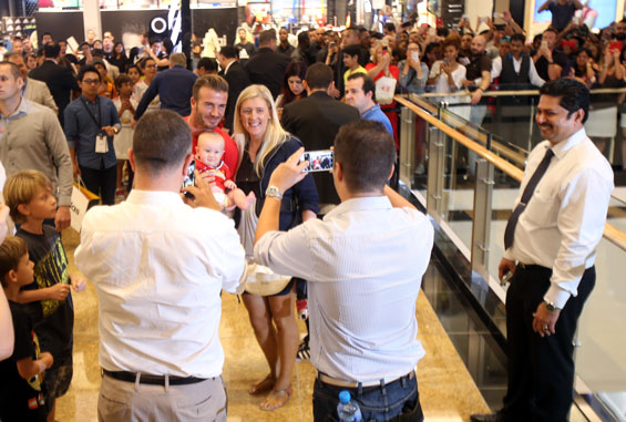David Beckham greets cheering crowd at the store opening (Supplied)