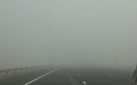 Abu Dhabi Police released this picture showing how fog cuts visibility on roads. (Supplied)
