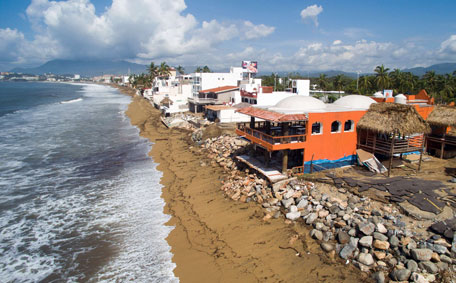 Aerial view of of Manzanillo beach in Colima State, Mexico on October 24, 2015 after the passage of hurricane Patricia. Patricia flattened dozens of homes on Mexico's Pacific coast, but authorities said Saturday the record-breaking hurricane largely spared the country as it weakened to a tropical depression.  (AFP)