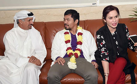 Manny Pacquiao (centre) and his wife Jinkee at the VIP Lounge of Al Majlis in Dubai Airport's Terminal 3 with Saeed Hareb (left), secretary general of the Dubai Sports Council on Monday. (Supplied)