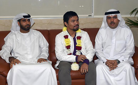 Manny Pacquiao with Dubai Sports Council officials Rashid Al Kamali (right) and Omran Al Jasmi (left) at the VIP Lounge in Al Majlis at Dubai Airport Terminal 3. (Supplied)