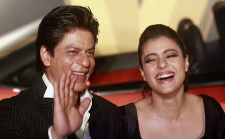 Indian actors Shah Rukh Khan and Kajol Devgn share a candid moment at the trailer launch of 'Dilwale'.