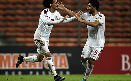 Omar Abdulrahman (left) of UAE celebrates with teammate Amer Abdulrahman after scoring a goal during the 2018 FIFA World Cup qualifying football match between Malaysia and UAE in Shah Alam on November 17, 2015. (AFP)