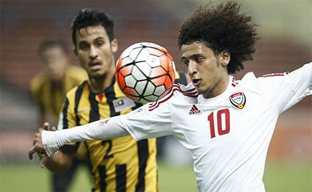 Omar Abdulrahman (right) of the UAE  vies for possession against Malaysia's Matthew Davies during the Group A World Cup 2018 qualifying match in Shah Alam, Malaysia on Tuesday, Nov. 17, 2015. (AP)