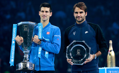 Serbia's Novak Djokovic and Switzerland's Roger Federer pose with their trophies after their match. (Reuters)