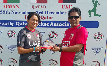 Shalani Wanniarachchi receiving her cap from UAE national women's coach Mohammed Hyder Kazmi before making her debut at the Gulf Cup. (Supplied)