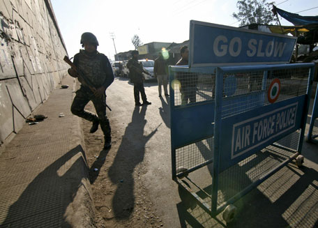 Indian security personnel stand guard next to a barricade outside the Indian Air Force (IAF) base at Pathankot in Punjab. (Reuters)