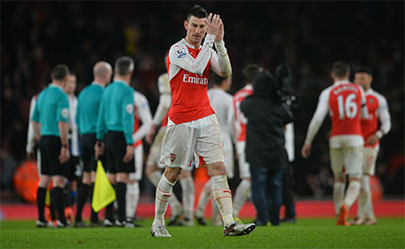 Arsenal's French defender Laurent Koscielny (centre) applauds the fans following the English Premier League football match between Arsenal and Newcastle United at the Emirates Stadium in London on January 2, 2016. (AFP)