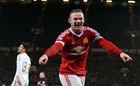 Manchester United's English striker Wayne Rooney celebrates scoring his team's second goal during the English Premier League football match between Manchester United and Swansea City at Old Trafford in Manchester, north west England, on January 2, 2016. (AFP)