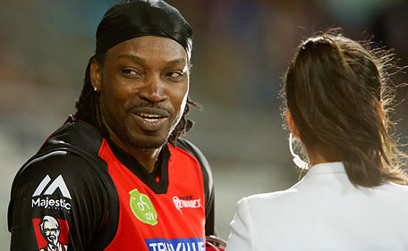 Chris Gayle of the Melbourne Renegades gives a TV interview to Mel Mclaughlin during the Big Bash League match between the Hobart Hurricanes and the Melbourne Renegades at Blundstone Arena on January 4, 2016 in Hobart, Australia. (Getty Images)