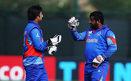 Asghar Stanikai and Shahzad Mohammadi of Afghanistan in action during the ICC World Twenty20 India Qualifier between UAE and Afghanistan at the Grange Cricket Club, on July 10, 2015 in Edinburgh Scotland. (Getty Images)