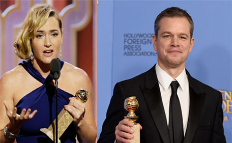 Matt Damon, Kate Winslet with thier respective awards at the 73rd annual Golden Globe Awards on Sunday, Jan. 10, 2016, at the Beverly Hilton Hotel in Beverly Hills, Calif. (AP)