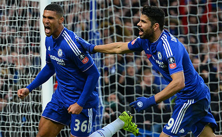 Chelsea's English midfielder Ruben Loftus-Cheek (left) celebrates with Chelsea's Brazilian-born Spanish striker Diego Costa after scoring his team's second goal during the FA Cup third-round football match between Chelsea and Scunthorpe United at Stamford Bridge in London on January 10, 2016. (AFP)