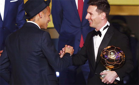 FC Barcelona's Lionel Messi of Argentina (right) shakes hand with FC Barcelona's Neymar of Brazil after receiving the World Player of the Year award during the FIFA Ballon d'Or 2015 ceremony in Zurich, Switzerland, January 11, 2016. (Reuters)