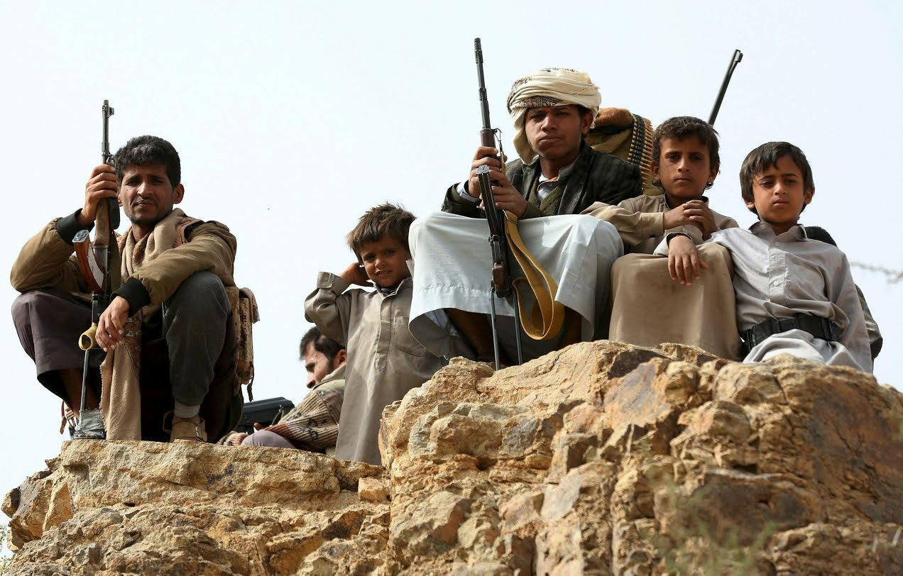 Tribal fighters loyal to Yemen's government and children pose for a picture in Al Khurais east of the capital Sanaa. (Agencies)
