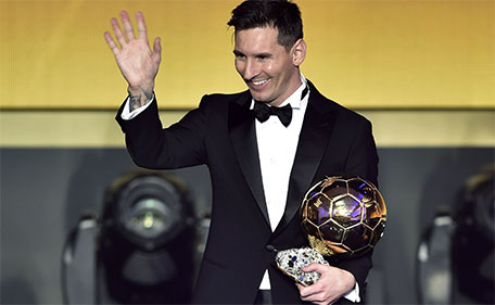 FC Barcelona and Argentina's forward Lionel Messi waves holding his trophy after receiving the 2015 FIFA Ballon d'Or award for player of the year during the 2015 FIFA Ballon d'Or award ceremony at the Kongresshaus in Zurich on January 11, 2016. (AFP)