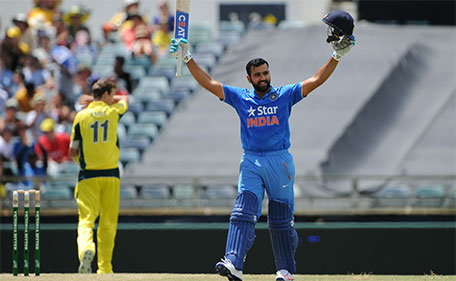 India's Rohit Sharma raises his bat after reaching 100 runs during the one-day international cricket match between India and Australia in Perth on January 12, 2016. (AFP)