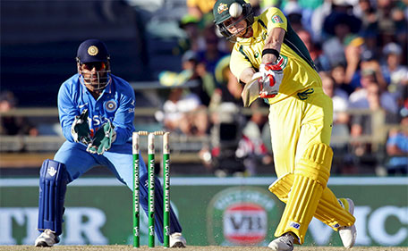 Australia's Steve Smith hits a six as India's wicketkeeper MS Dhoni looks on during the One Day International cricket match in Perth January 12, 2016. (Reuters)