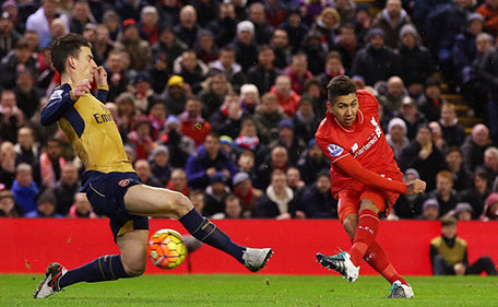Roberto Firmino of Liverpool scores his team's first goal during the Barclays Premier League match between Liverpool and Arsenal at Anfield on January 13, 2016 in Liverpool, England. (Getty)