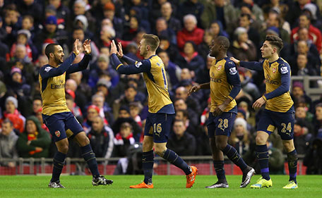 Aaron Ramsey (2nd left) of Arsenal celebrates scoring his team's first goal with his team mates Theo Walcott (1st left), Joel Campbell (2nd right) and Hector Bellerin (1st right) during the Barclays Premier League match between Liverpool and Arsenal at Anfield on January 13, 2016 in Liverpool, England. (Getty Images)