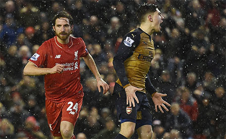 Liverpool's Welsh midfielder Joe Allen (left) celebrates after scoring during the English Premier League football match between Liverpool and Arsenal at Anfield stadium in Liverpool, England on January 13, 2016. (AFP)