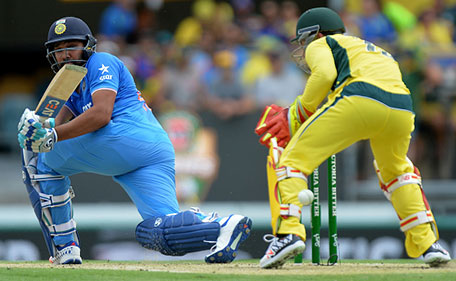 Rohit Sharma of India gets the ball past the keeper during game two of the Victoria Bitter One Day International Series between Australia and India at The Gabba on January 15, 2016 in Brisbane, Australia. (Getty Images)