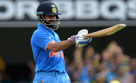 Virat Kohli of India celebrates scoring a half century during game two of the Victoria Bitter One Day International Series between Australia and India at The Gabba on January 15, 2016 in Brisbane, Australia. (Getty Images)