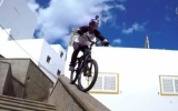 Photo: GoPro: Cyclist rides the rooftops