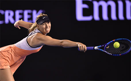 Russia's Maria Sharapova plays a backhand return during her women's singles match against Belarus's Aliaksandra Sasnovich on day three of the 2016 Australian Open tennis tournament in Melbourne on January 20, 2016. (AFP)