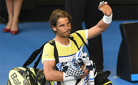 Spain's Rafael Nadal gestures as he leaves the court after defeat in his men's singles match against compatriot Fernando Verdasco on day two of the 2016 Australian Open tennis tournament in Melbourne on January 19, 2016. (AFP)