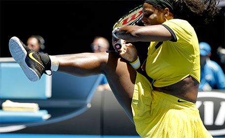 Serena Williams of the United States plays a backhand return to Hsieh Su-Wei of Taiwan during their second round match at the Australian Open tennis championships in Melbourne, Australia, Wednesday, Jan. 20, 2016. (AP)