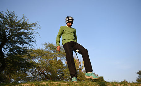 India's No. 1 junior golfer and junior world golf championship winner Shubham Jaglan, 11, practices at the Delhi Golf Club in New Delhi on December 15, 2015. (AFP)